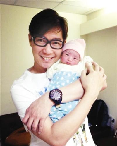 42岁品冠喜获一女小宝宝皱眉可爱(图)