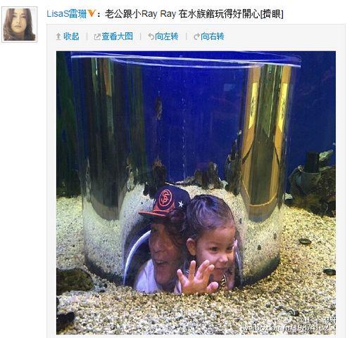 吴彦祖抱爱女水族馆玩耍两人开心大笑(图)