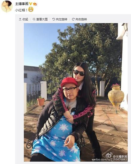 [热点新闻]李湘晒与王岳伦甜蜜合影 男方大肚成功抢镜(图)